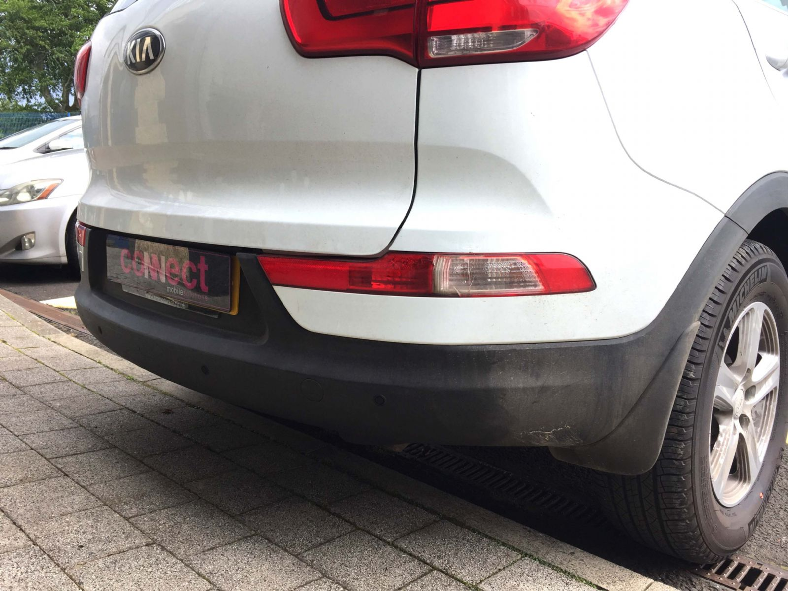 Kia  with matte black parking sensors installed in Maghera